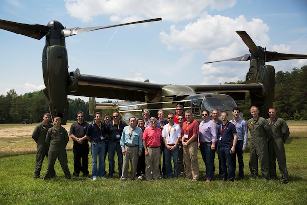 Participants of the Marine Corps Executive Forum pose for a photo with the flight crew of a MV-22 Osprey after taking a flight at Marine Corps Base Quantico on July 18, 2014. The 17-member forum experienced a day of Marine Corps tradition and operations as they watched a martial arts demonstration, toured the National Museum of the Marine Corps and experienced a parade at Marine Barracks Washington, D.C., in addition to the Osprey flight.
