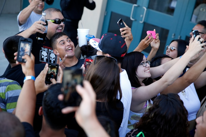 """Comedian Gabriel Iglesias takes selfies with fans at a sneak preview of his new movie """"Fluffy"""" at the Bulldog Box Office on Camp Pendleton July 18. The movie was free to the first 1,300 people in line."""