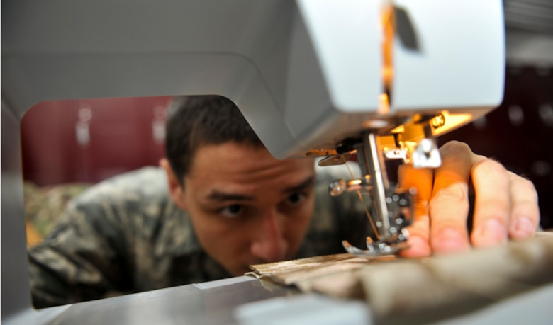 Senior Airman Devin Litton uses a sewing machine, July 18, 2014, at McConnell Air Force Base, Kan. Sewing is one of several skills an aircrew flight equipment Airmen must master to repair life rafts and other emergency tools. Litton is a 22nd Operations Support Squadron aircrew flight equipment journeyman. (U.S. Air Force photo/Airman 1st Class John Linzmeier)