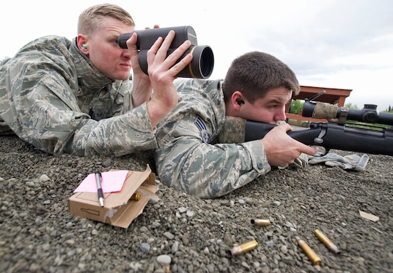 Senior Airman Aric Shott, left, uses a spotting scope to assist Senior Airman Austin Cavenaugh as they train with the M24 Sniper Weapon System July 11, 2014, at Joint Base Elmendorf-Richardson, Alaska. The M24 is a military version of the Remington Model 700, a 7.62 mm rifle, and has been in service with the U.S. military since 1988. Both Airmen are assigned to assigned to the 673rd Security Forces Squadron. Shott is a a native of West Palm Beach, Fla. Cavenaugh is a native of Beulaville, N.C. (U.S. Air Force photo/Justin Connaher)