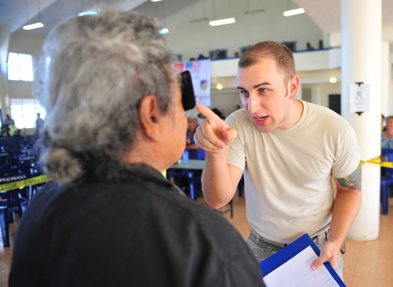 Staff Sgt. Nicholas Hubbard screens a patient during an eye exam July 21, 2014, in Neiafu, Tonga. A health services outreach was held during Operation Pacific Angel-Tonga to provide acute healthcare, educate citizens on health issues and work with the local hospital for referral services. Hubbard is deployed from Kadena Air Base, Japan. Hubbard is an optometry technician. (U.S. Air Force photo/Staff Sgt. Rachelle Coleman)