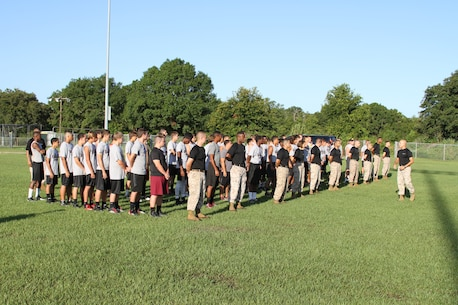 Staff Sgt. Franky Rodriguez, station commander of Recruiting Substation Kissimmee, prepares to lead Marines and football players in a dynamic warm up at St. Cloud High School, St. Cloud, Fl, July 22, 2014. Football players learned about leadership principals and traits while exercising with Marines.