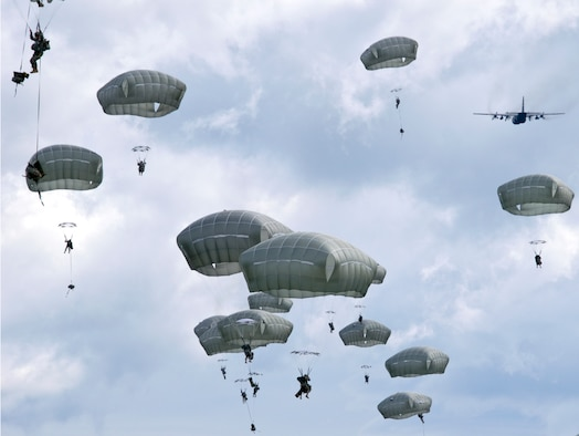 Paratroopers with the 4th Infantry Brigade Combat Team (Airborne), 25th Infantry Division jump from an Alaska Air National Guard C-130 Hercules here as part of a Joint Force Entry Exercise on June 7, 2014. The six-day exercise involved more than 1,500 personnel including active duty Army, Air Force and Air National Guard. (U.S. Air National Guard Photo by Capt. John Callahan)