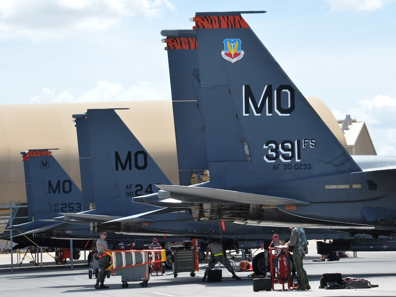 Flightline and aircraft crews prepare 391st Fighter Squadron F-15E Strike Eagles for a mission July 16, 2014, at Joint Base Pearl Harbor-Hickam, Hawaii. The 391st FS is currently on a two-month deployment here from Mountain Home Air Force Base, Idaho. While here, the squadron's F-15Es have participated in Rim of the Pacific 2014 exercise missions. RIMPAC is a U.S. Pacific Command-hosted biennial multinational maritime exercise designed to foster and sustain international cooperation on the security of the world's oceans. (U.S. Air Force photo by Staff Sgt. Alexander Martinez/Released)
