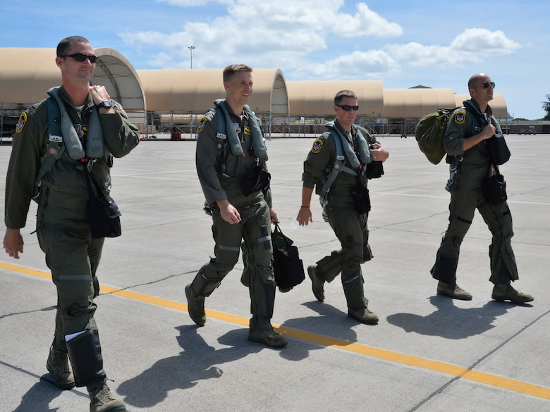 391st Fighter Squadron F-15E Strike Eagle pilots and weapon systems officers step to their aircrafts during a mission July 16, 2014, at Joint Base Pearl Harbor-Hickam, Hawaii. The 391st FS is currently on a two-month deployment here from Mountain Home Air Force Base, Idaho. While here, the squadron's F-15Es have participated in Rim of the Pacific 2014 exercise missions. RIMPAC is a U.S. Pacific Command-hosted biennial multinational maritime exercise designed to foster and sustain international cooperation on the security of the world's oceans. (U.S. Air Force photo by Staff Sgt. Alexander Martinez/Released)