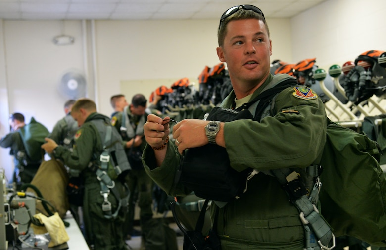 Capt. Scott Harbison, 391st Fighter Squadron F-15E Strike Eagle pilot, gears up for a mission July 16, 2014, at Joint Base Pearl Harbor-Hickam, Hawaii. The 391st FS is currently on a two-month deployment here from Mountain Home Air Force Base, Idaho. While here, the squadron's F-15Es have participated in Rim of the Pacific 2014 exercise missions. RIMPAC is a U.S. Pacific Command-hosted biennial multinational maritime exercise designed to foster and sustain international cooperation on the security of the world's oceans. (U.S. Air Force photo by Staff Sgt. Alexander Martinez/Released)
