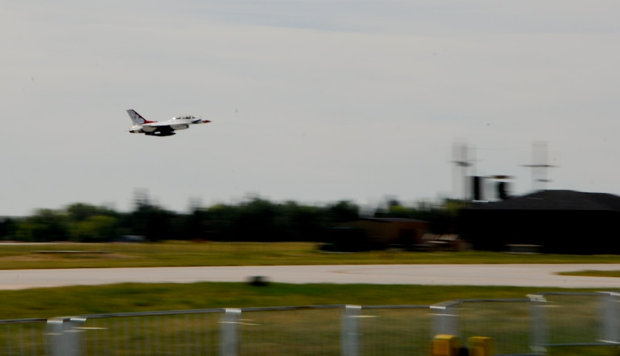 Maj. Mike Fisher, U.S. Air Force Thunderbirds #8 advance pilot and narrator, takes off in his Thunderbirds F-16 carrying Cory Sullivan, Root Sports analyst and former Colorado Rockies Outfielder, July 21, 2014, at the Wyoming Air National Guard base in Cheyenne, Wyo. Sullivan described the flight as intense, and said he is impressed the pilots can control the jet while exposed to strong g-forces. (U.S. Air Force photo by Airman 1st Class Jason Wiese)