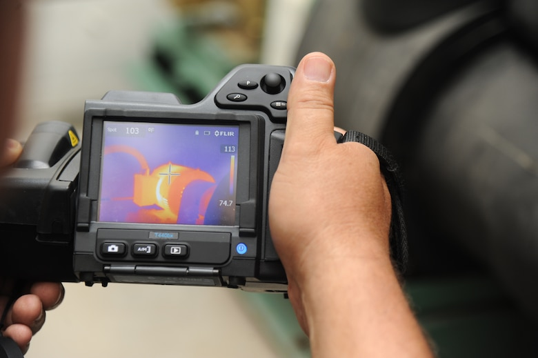 John Grant, Base Operations Support contractor, uses a Thermal Imaging System used for detecting mechanical hot spots inside the 41st Aerial Port building mechanical room July 18, 2014, at Keesler Air Force Base, Miss.  This system is utilized as part of the Reliability Centered Maintenance program which evaluates equipment performance piece by piece to determine wear and lifecycle of each item.  The goal of the program is to institute the most cost effective plan for maintaining complex systems and minimize equipment failure or downtime. (U.S. Air Force photo by Kemberly Groue)