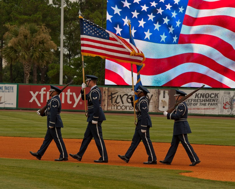 Joint Base Charleston Honor Guard posts the colors for Military Appreciation night at the Charleston RiverDogs game Aug. 21, 2013, at Joseph P. Riley Jr. ballpark in Charleston, S.C. The Charleston RiverDogs hosted Military Appreciation Night to show their support for the local military. (U.S. Air Force photo/ Staff Sgt. William A. O'Brien)