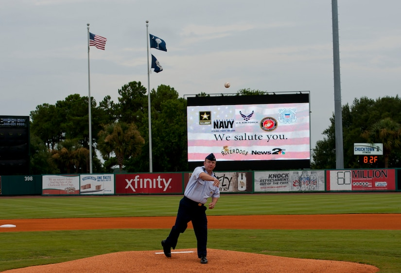 Col. Jeffrey DeVore, Joint Base Charleston commander, delivers the ceremonial first pitch during Military Appreciation Night July 19, 2014, at Joseph P. Riley Jr. ballpark in Charleston, S.C. The Charleston RiverDogs hosted Military Appreciation Night to show their support for the local military. (U.S. Air Force photo/ Staff Sgt. William A. O'Brien)