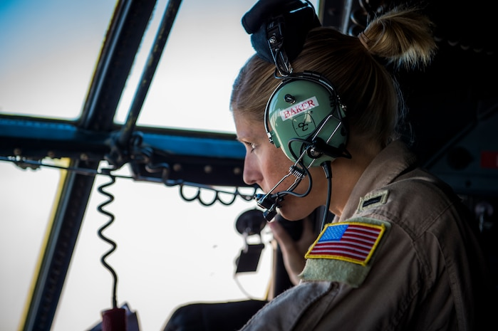 U.S. Air Force 1st Lt. Shannon Baker, 737th Expeditionary Airlift Squadron C-130H navigator, looks out the window of a C-130H Hercules during flight July 20, 2014 at an undisclosed location in Southwest Asia. Baker deployed here from the 910th Airlift Wing, Youngstown Air Reserve Station, Ohio in support of Operation Enduring Freedom. (U.S. Air Force photo by Staff Sgt. Jeremy Bowcock)