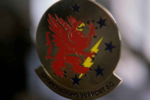 A trinket with the 52nd Operations Support Squadron emblem is displayed inside the air crew flight equipment shop July 15, 2014, at Spangdahlem Air Base, Germany. The 52nd OSS was constituted on Jan. 25, 1943, and activated on Feb. 1, 1943, in support of World War II. (U.S. Air Force photo by Senior Airman Rusty Frank/Released)