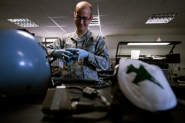 U.S. Air Force Daniel Sisler, a 52nd Operations Support Squadron air crew flight equipment technician from Somerset, Wis., performs a periodic 30-day inspection on a pilot's helmet July 15, 2014, at Spangdahlem Air Base, Germany. AFE members are responsible for maintaining and fitting all pilots with their equipment. (U.S. Air Force photo by Senior Airman Rusty Frank/Released)