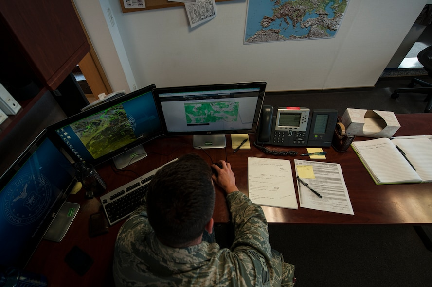 U.S. Air Force Staff Sgt. Michael Nelson, 52nd Operations Support Squadron NCO in charge of mission weather element from Kingsville, Texas, participates in a meteorological conference July 15, 2014, at Spangdahlem Air Base, Germany. Members of the weather flight hold the conference two or three times a week to keep their members aware of the weather forecast. (U.S. Air Force photo by Senior Airman Rusty Frank/Released)