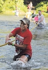 Addy Falaniko makes her way across the Big Piney River during the Marine Corps Detachment's 10k Volkslauf mud run. More than 1,200 people turned out for the event.