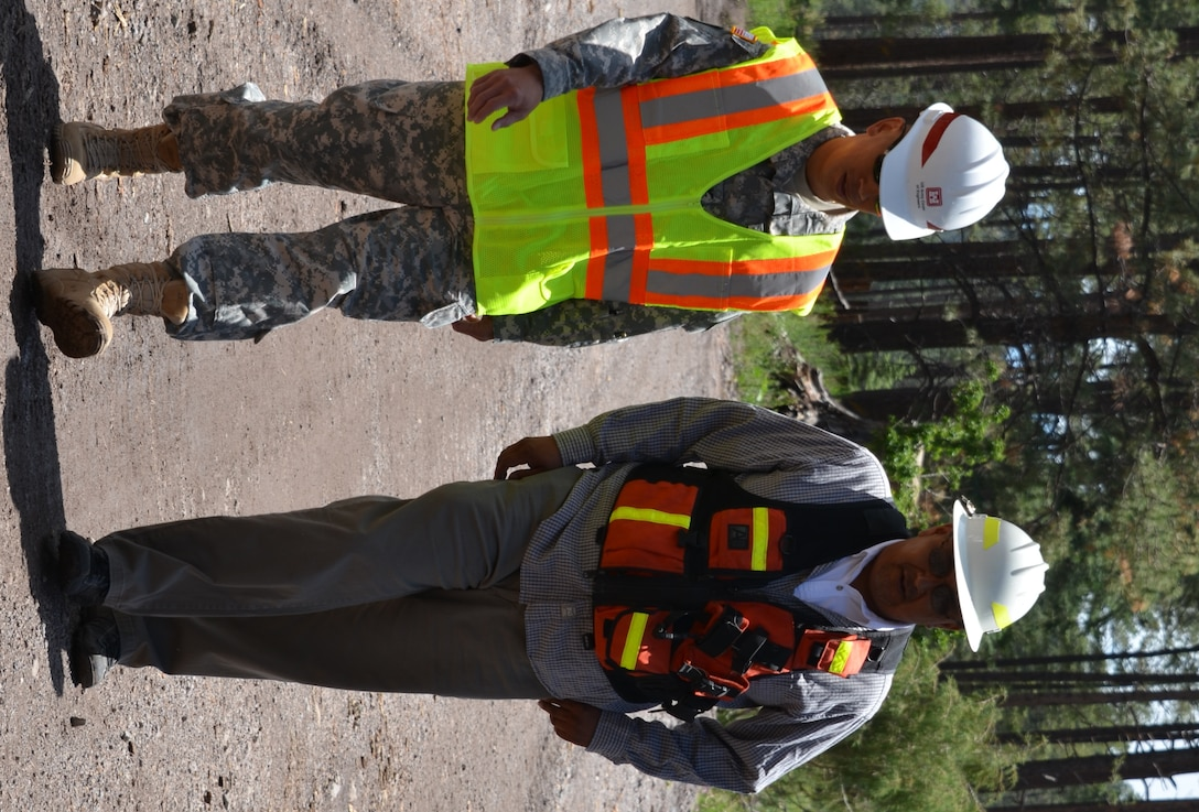 Brig. Gen. Mark Toy, South Pacific Division Commander, left, discusses flood risk management measures and options with Michael Chavarilla, governor, Santa Clara Pueblo, while visiting the Santa Clara burn scar area.