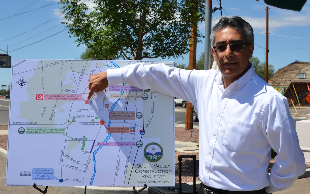 ALBUQUERQUE, N.M., -- Jerry Nieto, project manager, U.S. Army Corps of Engineers, Albuquerque District, points to where construction of the Southwest Valley Flood Reduction Phase 2C Project will occur.  Nieto recently attended a media conference, organized by Bernalillo County, to discuss a variety of projects under construction in the Southwest Valley.