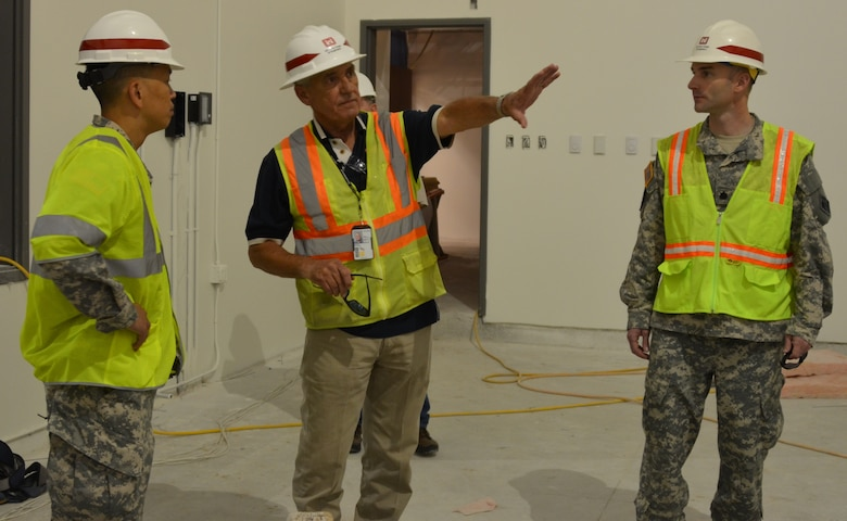 KIRTLAND AIR FORCE BASE, N.M., -- COL (P) Mark Toy, South Pacific Division Commander (left) and LTC Dagon, Albuquerque District Commander (right) receive a briefing from John Wilson, project engineer, Kirtland Resident Office, on the Sustainment Center project at Kirtland Air Force Base.