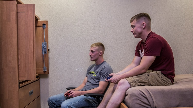 Lance Cpl. Benjamin J. Provoznik, left, intelligence specialist, 15th Marine Expeditionary Unit, relaxes from the stressors of work by playing video games with a friend aboard Camp Pendleton, Calif., July 19, 2014. Provoznik, 19, is from Wilmington, Ohio. (U.S. Marine Corps video by Cpl. Emmanuel Ramos/Released)
