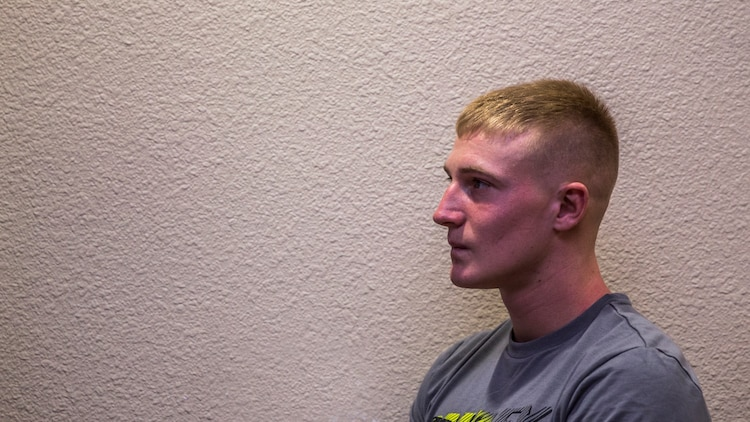 Lance Cpl. Benjamin J. Provoznik, intelligence specialist, 15th Marine Expeditionary Unit, relaxes from the stressors of work by playing video games aboard Camp Pendleton, Calif., July 19, 2014. Provoznik, 19, is from Wilmington, Ohio. (U.S. Marine Corps video by Cpl. Emmanuel Ramos/Released)