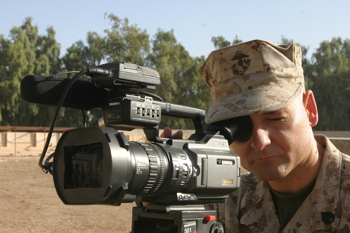 On 30 September 2006, Staff Sergeant Benjamin E. Barr, a Combat Videographer with I Marine Expeditionary Force Combat Camera, documents a graduation ceremony for new Iraqi Soldiers of Basic Training Class 4 (BTC-4) on Camp Habaniyah, Iraq.  Regimental Combat Team 5 is deployed with I Marine Expeditionary Force in support of Operation Freedom in the Al Anbar Province of Iraq (Multi-National Forces-West) to develop the Iraqi Security Forces, facilitate the development of official rule of law through democratic government reforms, and continue the development of a market based economy centered on Iraqi Reconstruction. (U.S. Marine Corps photo by Sgt Adaecus G. Brooks) (RELEASED)