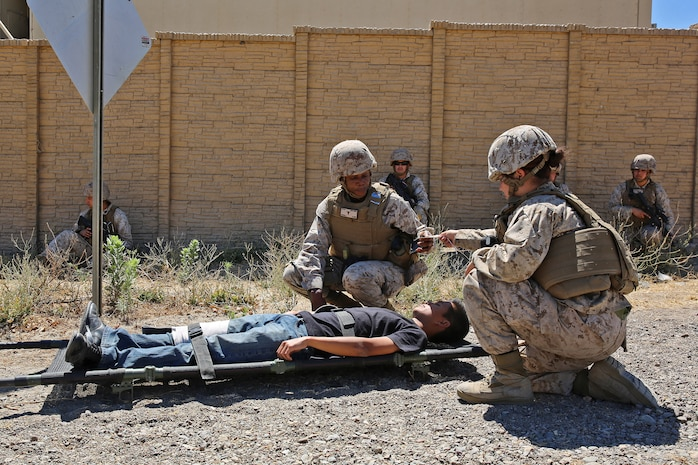 Marines and corpsmen with Combat Logistics Battalion 15, 1st Marine Logistics Group, provide security and prepare a simulated casualty for medical evacuation during a humanitarian aid exercise as part of CLB-15's pre-deployment training with the Special Operations Training Group, 1st Marine Expeditionary Force, aboard Camp Pendleton, Calif., July 16, 2014. The exercise took place over the course of three days, and provided CLB-15 with a realistic and immersive experience. The simulation, set up by SOTG, put CLB-15's Marines and sailors in the middle of a typhoon-ravaged rural Philippine area where they were tasked with providing humanitarian aid and disaster relief, similar to the situation faced by Marines with the 3rd Marine Expeditionary Force during the aftermath of Typhoon Haiyan in 2013. CLB-15 is slated to deploy with the 15th Marine Expeditionary Unit, 1st Marine  Expeditionary Force.