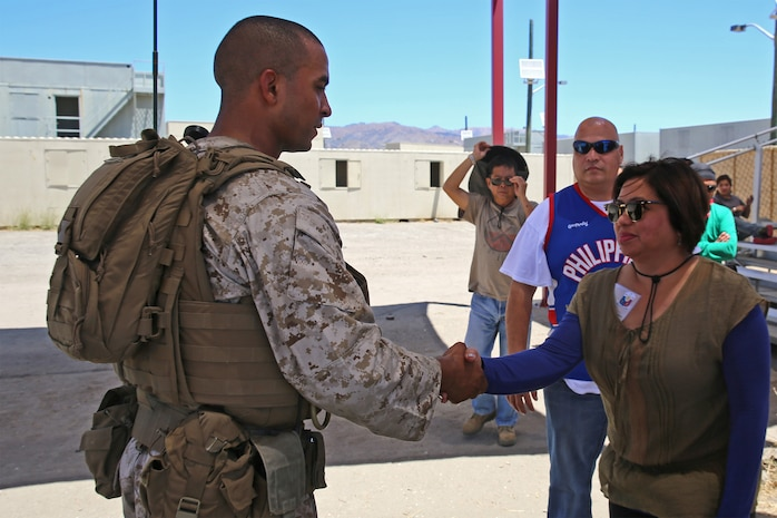Ruby Santos, right, a role-player, meets 1st Lt. Nikolas Gillespie, left, survey team officer-in-charge with Combat Logistics Battalion 15, Headquarters Regiment, 1st Marine Logistics Group, while functioning as a mayor for an area in need of humanitarian assistance as part of CLB-15's pre-deployment training with the Special Operations Training Group, 1st Marine Expeditionary Force, aboard Camp Pendleton, Calif., July 16, 2014. The exercise took place over the course of three days and provided CLB-15 with a realistic and immersive experience. The fog of war, language barriers and logistical issues were  just a few of the problems the Marines and sailors faced. CLB-15 is slated to deploy with the 15th Marine Expeditionary Unit, 1st Marine Expeditionary Force.