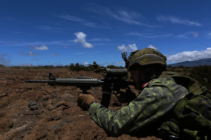 POHAKULOA TRAINING AREA, Hawaii - A soldier with Princess Patricia's Canadian Light Infantry fires off his weapon at a target during a live fire shoot, as part of Rim of the Pacific (RIMPAC) Exercise 2014, July 18. Twenty-two nations, more than 40 ships and submarines, about 200 aircraft and 25,000 personnel are participating in RIMPAC from June 26 to Aug. 1 in and around the Hawaiian Islands and Southern California. The world's largest international maritime exercise, RIMPAC provides a unique training opportunity that helps participants foster and sustain the cooperative relationships that are critical to ensuring the safety of sea lanes and security on the world's oceans. RIMPAC 2014 is the 24th exercise in the series that began in 1971. (U.S. Marine Corps photo by Cpl. Erik Estrada/Released)