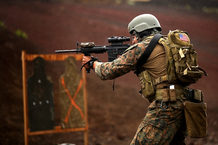 POHAKULOA TRAINING AREA, Hawaii – A U.S. Marine assigned to third  platoon, Alpha Company, 3d Reconnaissance Battalion, fires rounds from his M4 service rifle during lateral movement shooting on Range 8, Pohakuloa Training Area, Hawaii during Rim of the Pacific (RIMPAC) Exercise 2014, July 19. Twenty-two nations, 49 ships and six submarines, more than 200 aircraft and 25,000 personnel are participating in RIMPAC from June 26 to Aug. 1 in and around the Hawaiian Islands and Southern California. The world's largest international maritime exercise, RIMPAC provides a unique training opportunity that helps participants foster and sustain the cooperative relationships that are critical to ensuring the safety of sea lanes and security on the world's oceans. RIMPAC 2014 is the 24th exercise in the series that began in 1971. (U.S. Marine Corps photo by Cpl. Matthew Callahan/Released)