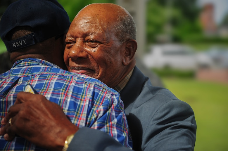 Retired Staff Sgt. Elbert Scott hugs a fellow veteran after a medal presentation ceremony in his honor, July 21, 2014, in downtown Goldsboro, N.C. Scott served at Seymour Johnson Air Force Base with the 4th Supply Squadron until his honorable discharge in 1962. (U.S. Air Force photo/Airman 1st Class Brittain Crolley)