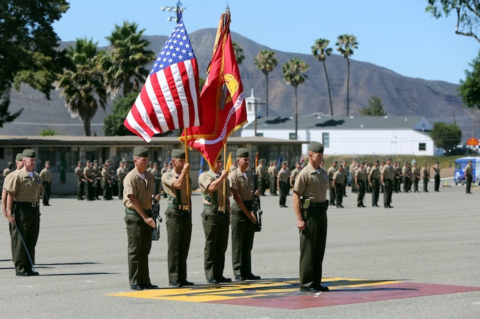 Colonel Stephen Liszewski, from Gaithersburg, Md., and the former commanding officer of 11th Marine Regiment, stands in front of the colors during the regimental change of command ceremony aboard Marine Corps Base Camp Pendleton, Calif., July 22, 2014. Liszewski relinquished command as commanding officer and was awarded the Legion of Merit. (U.S. Marine Corps photo by Lance Cpl. David Silvano/released)