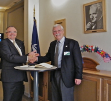 Signing the visitor book at NATO-CSO, left to right: René LaRose, Director NATO Collaboration Support Office and Dr. Russell Harmon, Director ERDC International Research Office.
