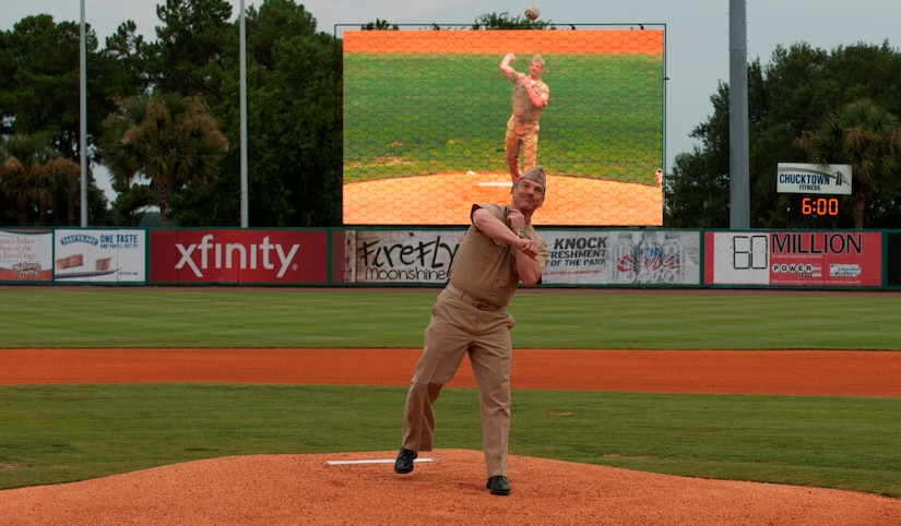 Master Chief Petty Officer Ronald Nagy, Naval Nuclear Propulsion Training Command command master chief, delivers the ceremonial first pitch during Military Appreciation Night July 19, 2014, at Joseph P. Riley Jr. ballpark in Charleston, S.C. The Charleston RiverDogs hosted Military Appreciation Night to show their support for the local military. (U.S. Air Force photo/ Staff Sgt. William A. O'Brien)