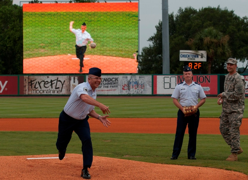 Chief Master Sgt. David Wade, 437th Maintenance Group superintendent, delivers a ceremonial first pitch during Military Appreciation Night July 19, 2014, at Joseph P. Riley Jr. ballpark in Charleston, S.C. The Charleston RiverDogs hosted Military Appreciation Night to show their support for the local military. (U.S. Air Force photo/ Staff Sgt. William A. O'Brien)