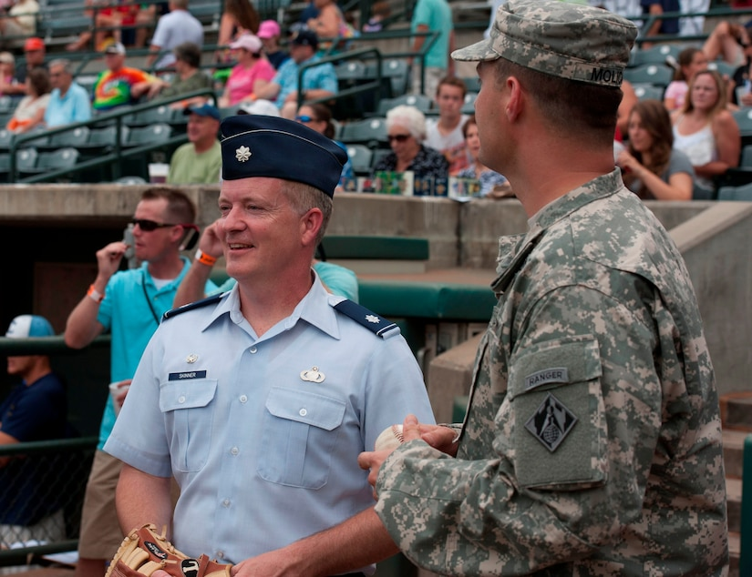 Lt. Col. Dale Skinner, 628th Contracting Squadron commander, prepares to throw his first-ever ceremonial first pitch during Military Appreciation Night July 19, 2014, at Joseph P. Riley Jr. ballpark in Charleston, S.C. More than 5,000 fans were in attendance for the game, which honored local military members. (U.S. Air Force photo/ Staff Sgt. William A. O'Brien)