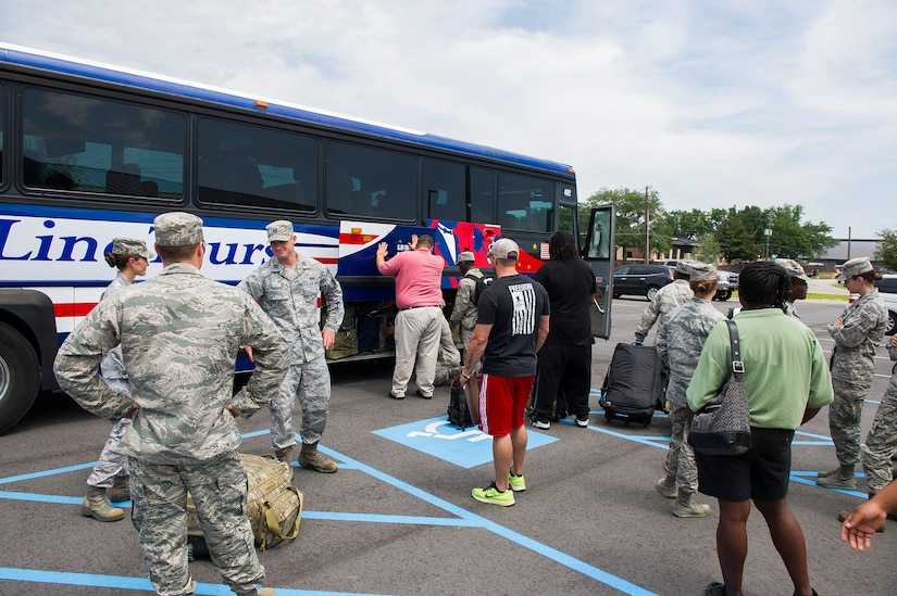 Members of the 628th Civil Engineer Squadron prepare for deployment to Guantanamo Bay, Cuba, July 17, 2014, at Joint Base Charleston, S.C. Members of the 628th CES deployed to Guantanamo Bay for installation support. (U.S. Air Force photo/Senior Airman George Goslin)