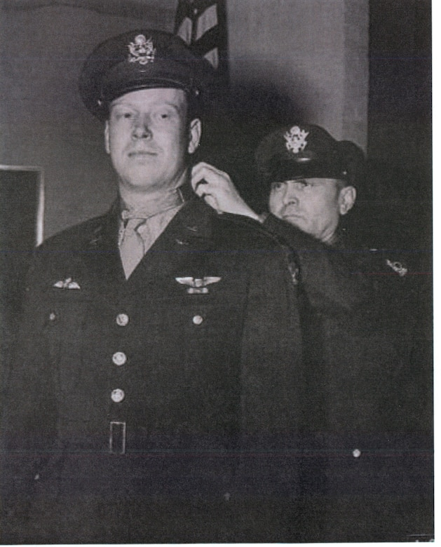 """2nd Lt. John C. """"Red"""" Morgan is presented the Medal of Honor by Gen. Ira C. Eaker after returning an unbelievably damaged B-17 Flying Fortress and crew home following a bombing mission with fatal ramifications over Germany during World War II, Dec. 18, 1943. (U.S. Air Force photo)"""