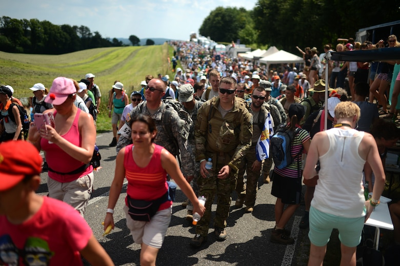 Members of the U.S. Army 361st Civil Affairs Brigade and U.S. Air Force 52nd Fighter wing participating in the International Four Days Marches Nijmegen alongside civilian participants in Nijmegen, Netherlands, July 17, 2014. More than 42,000 participants began the four-day-walk in Nijmegen and its surroundings. (U.S. Air Force photo by Senior Airman Gustavo Castillo/Released)