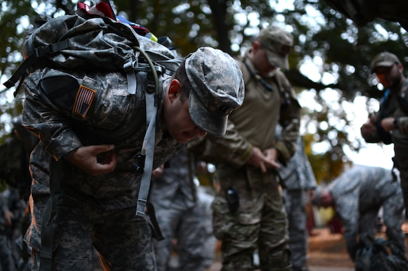 U.S. Army Capt. Patrick Muldoon, 52nd Fighter Wing ground liaison officer dons his ruck during the International Four Days Marches Nijmegen in Nijmegen, Netherlands, July 16, 2014. Military participants in the event had to march with a ruck that weighed a minimum of ten kilograms at all times, or face disqualification of the final award. (U.S. Air Force photo by Senior Airman Gustavo Castillo/Released)