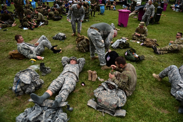 Members of the U.S. Army 361st Civil Affairs Brigade and U.S. Air Force 52nd Fighter Wing take a break during day one of the International Four Days Marches Nijmegen in Nijmegen, Netherlands, July 15, 2014. Participants in the event walked 140 kilometers in four days in order to earn the royally approved decoration, the Four Days Marches Cross, which Dutch servicemen may wear on their uniform. (U.S. Air Force photo by Senior Airman Gustavo Castillo/Released)