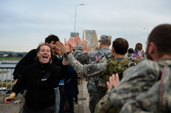 Spectators greet International Four Days Marches Nijmegen participants from the U.S. Army 361st Civil Affairs Brigade and U.S. Air Force 52nd Fighter Wing before crossing a bridge in Nijmegen, Netherlands, July 15, 2014. Spectators in every town along the route filled the street cheering on the march participants. (U.S. Air Force photo by Senior Airman Gustavo Castillo/Released)