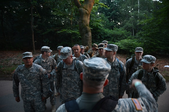 A group of U.S. Airmen and Army members from the U.S. Army 361st Civil Affairs Brigade and the U.S. Air Force 52nd Fighter Wing form up before the first day of the International Four Days Marches Nijmegen in Nijmegen, Netherlands, July 15, 2014. The 98th International Four Days Marches Nijmegen has grown into the largest multi-day walking event in the world. (U.S. Air Force photo by Senior Airman Gustavo Castillo/Released)
