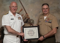 Rear Adm. Mark Tidd,left, head of the Chaplain Corps, stands with Navy Capt. Bryan Weaver, year's John H. Craven Servant Leadership Award on July 18, 2014, on Parris Island, S.C. The annual award is peer nominated and named after Chaplain John H. Craven for his selfless dedication to providing support for Marines and sailors through some of the worst battles of World War II and Korea. Weaver is from Roaring Spring, Pa.  (Photo by Cpl. David Bessey)