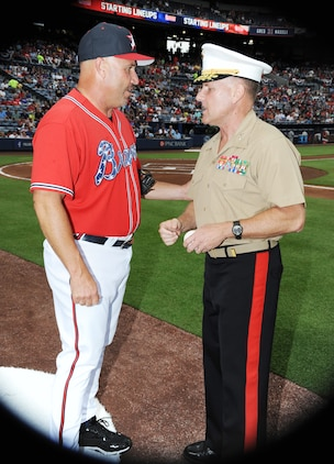 Maj. Gen. John J. Broadmeadow, commanding general, Marine Corps Logistics Command, receives an autographed baseball from Atlanta Braves manager Fredi Gonzalez during the pre-game tribute, July 19.  Broadmeadow threw out the celebratory first pitch as part of the Marine Corps Appreciation Day at Turner Field in Atlanta, Georgia.