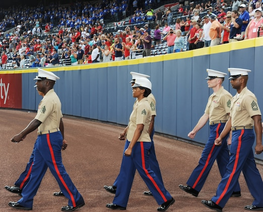 More than 60 Marines march onto Turner Field in Atlanta, Georgia, during the Atlanta Braves' Marine Corps Appreciation Day game, July 19.