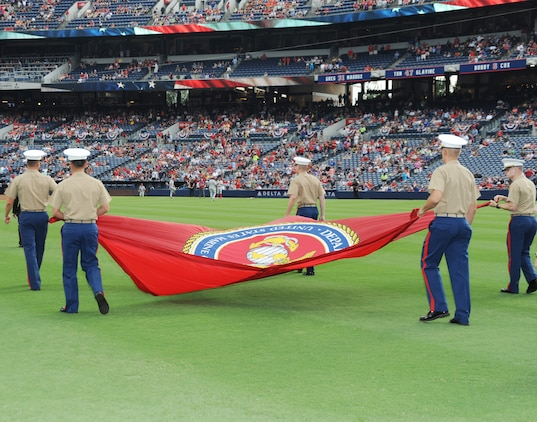 Marine officers carry the Marine Corps flag onto Turner Field in Atlanta, Georgia, prior to the Atlanta Braves baseball game, July 19, as part of the Braves' Marine Corps Appreciation Day.