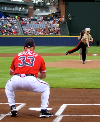 Maj. Gen. John J. Broadmeadow throws the first pitch at the Atlanta Braves game during the Marine Corps Appreciation Day at Turner Field in Atlanta, Georgia, July 19. The celebration included Col. Don Davis, commanding officer, Marine Corps Logistics Base Albany, being the honorary team captain and a tribute to recent Medal of Honor recipient Marine Cpl. Kyle Carpenter. The Atlanta Braves even donned military-themed jerseys that will be auctioned online to benefit the United Military Care, Inc.
