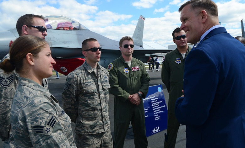 Gen. Frank Gorenc speaks with Airmen during a static display tour July 14, 2014, at the Farnborough International Airshow in England. Participation in FIA highlights the strength of the U.S. commitment to the security of NATO, the strong alliance with the U.K., and demonstrates interoperability with allies and the defense industry state-of-the-art capabilities. Gorenc is the the U.S. Air Forces in Europe-Air Forces Africa and Allied Air Command commander. (U.S. Air Force photo/Airman 1st Class Erin O'Shea)