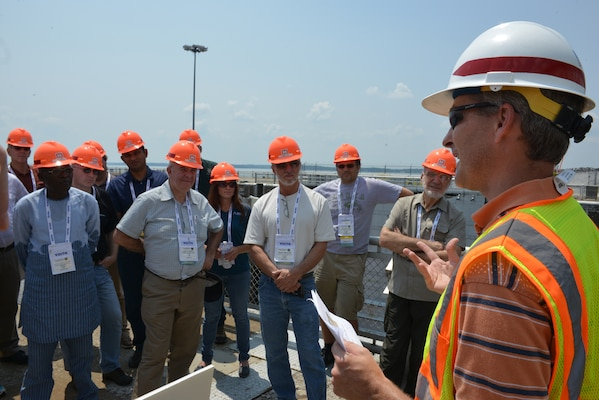Adam Walker, Project Manager for the Kentucky Lock Addition briefs a tour group about the construction during a visit to the Kentucky Lock Addition construction site on July 22, 2014. The group is attending the HydroVision conference in Nashville, Tenn., at the Music City Center. The four-day event, which has been held for two decades, highlights the work of the U.S. Army Corps of Engineers.