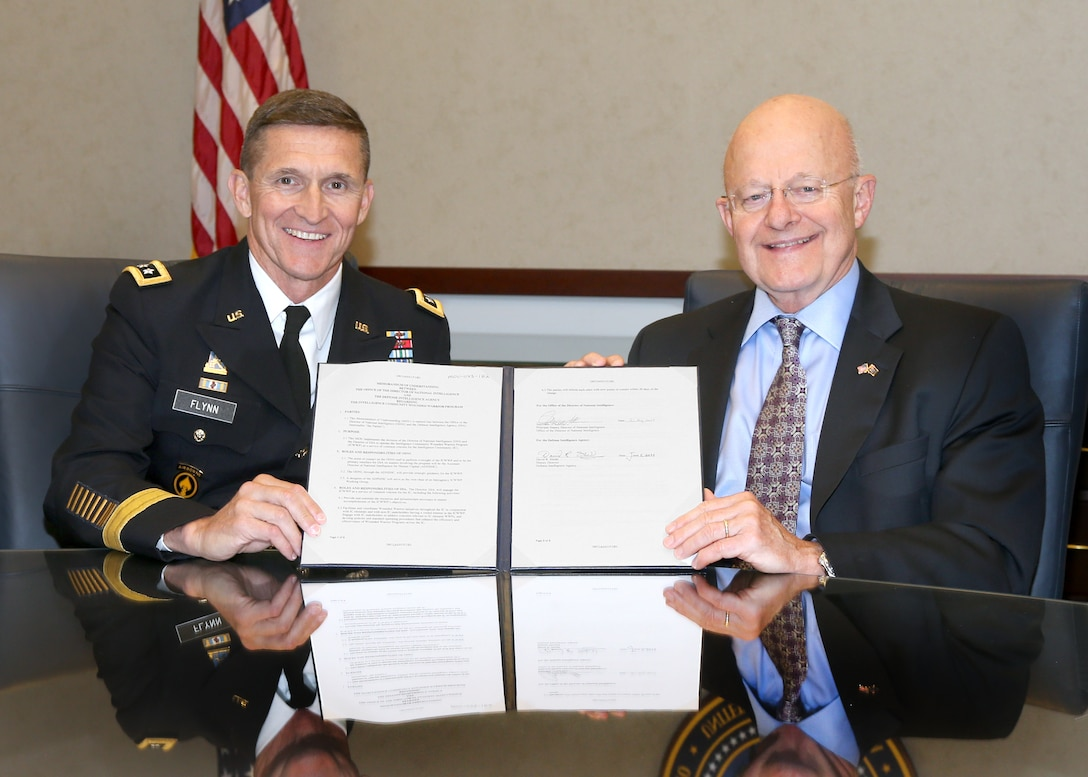 DIA Director Lt. Gen. Michael Flynn and Director of National Intelligence James Clapper acknowledge the official transfer of responsibility for the IC Wounded Warrior Program with a memorandum of understanding at ODNI Headquarters June 24. The MOU reflects the DNI's continuing responsibilities for strategic oversight of the program and DIA's day-to-day, IC-wide program management responsibilities.